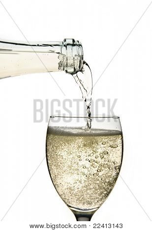 sparkling wine in a glass  isolated on a white background