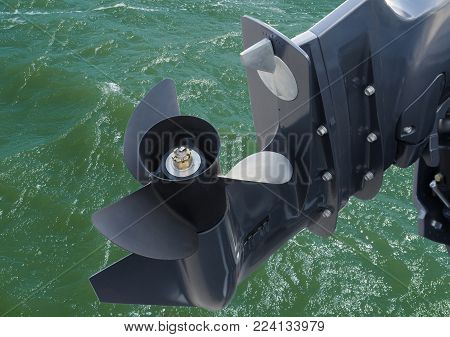 screw of motor boat on sea water background
