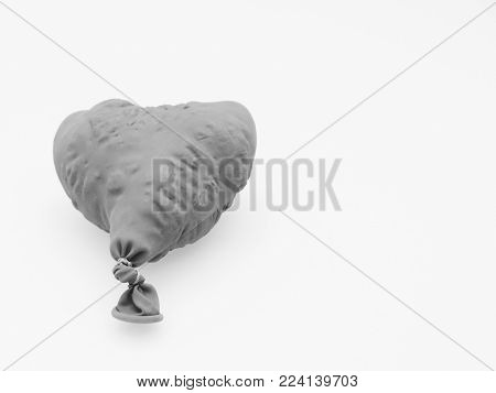 Deflate heart shape balloon in black and white isolated on white background shows broken heart, disappointed or painful relationship
