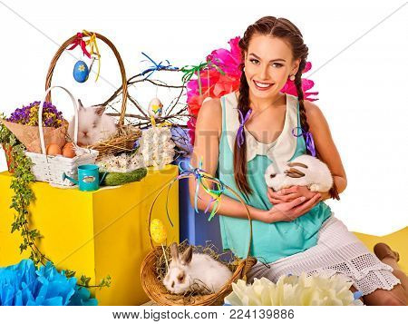 Easter dresses for women. Girl holding bunny and eggs. Woman with holiday hairstyle and make up touch rabbit in basket with flowers. Adults at festival. Easter and spring discounts.