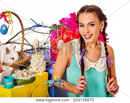 Easter dresses for women. Girl with bunny background. Woman with holiday hairstyle and make up holding rabbit in eggs basket with flowers festival. Easter and spring discounts on products for women.