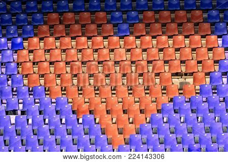 Red seats heart in stadion, health sport concept