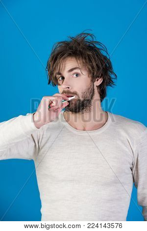Happy Man With Beard Grooming On Blue Background. Man With Disheveled Hair In Underwear Brush Teeth.