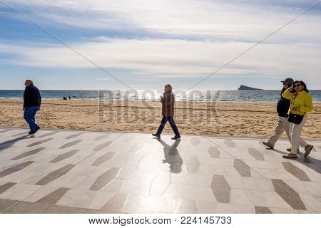 Benidorm, Spain - January 14, 2018: People walking on the promenade, Benidorm, Costa Blanca, Spain.