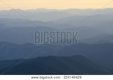Sunlit mountains ranges. Morning scene. May be use as background.