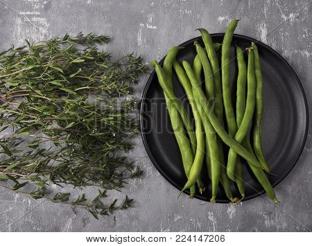 Colorful and crisp image of beans and savory on concrete