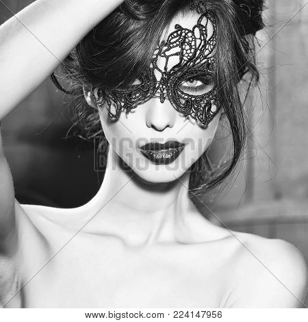 Portrait Of Attractive Mysterious Sexy Young Sensual Woman With Brunette Hair In Lace Black Mask Loo