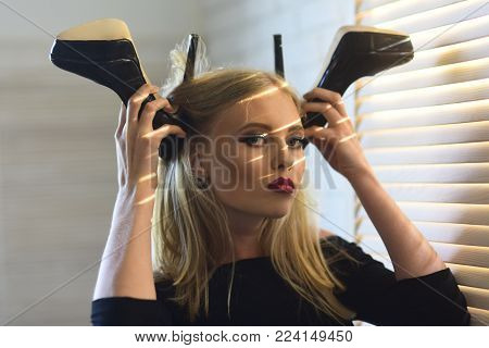 Sensual woman with fashionable shoes, fashion. woman with high heels and blond long hair, hairstyle.