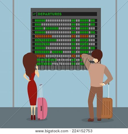 People at airport waiting and looking at departures board.
