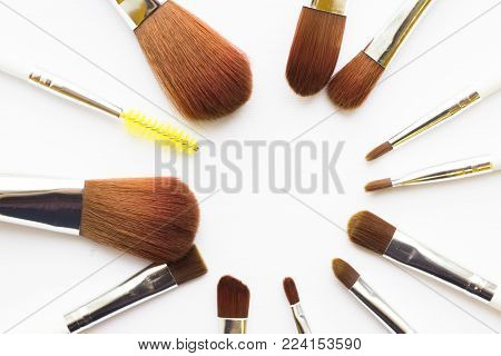 Make Up Beauty Concept. Set of make up brushes for lipstick, eyeshadows, foundation, powder, eyeliner and blusher on white background with copy space, top view, flat lay