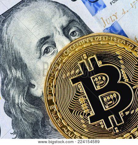 Bitcoin. Crypto currency Bitcoin, BTC, Bit Coin. Bitcoin golden coin on dollar banknote. Blockchain technology, bitcoin mining concept