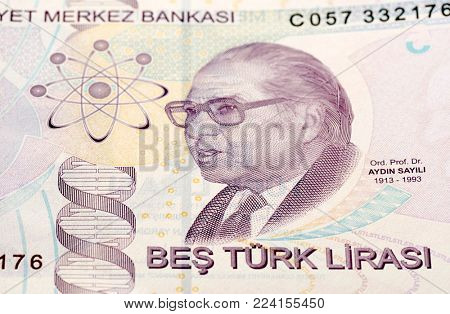 Close-up of Turkish paper currency five Lira with wrong DNA wrapped.