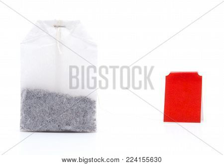 Closeup of teabag with red label isolated on white background