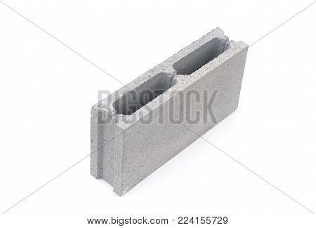 Concrete construction block, building material on white background.