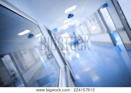 Bright Aisle Of A Building Of Health Care Occupancies, Unfocused Background.