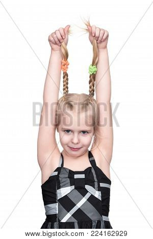Little girl grabbed herself by pigtails and raised her hands up, isolated on white background poster
