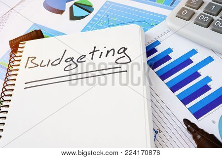 Budgeting written in note pad. Budget concept.