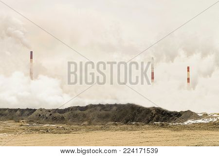 Excessive pollution of the environment. Dense factory strong smog with smoking chimneys of heavy industry background. Ecological disaster concept.