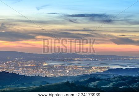 Silicon Valley Views from above. Santa Clara Valley at dusk as seen from Lick Observatory in Mount Hamilton east of San Jose, Santa Clara County, California, USA.
