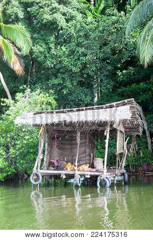 Madu Ganga, Balapitiya, Sri Lanka - Having a break at a traditional river shop during a boat safari