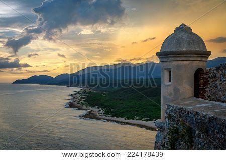 San Pedro de La roca fort walls and tower, sunset view with sea and Carribean coastline, Santiago De Cuba, Cuba