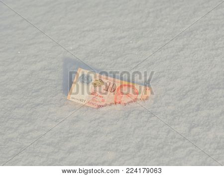 Banknote Of Ten Turkish Lira In The Snow. Frozen Accounts. Bankruptcy. Concept