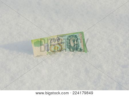 Banknote of 200 old Hungarian forints samples withdrawn from circulation dropped down to the snow
