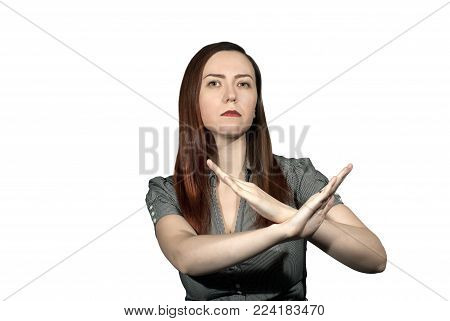 woman on a white background crossed her arms in a forbidding gesture