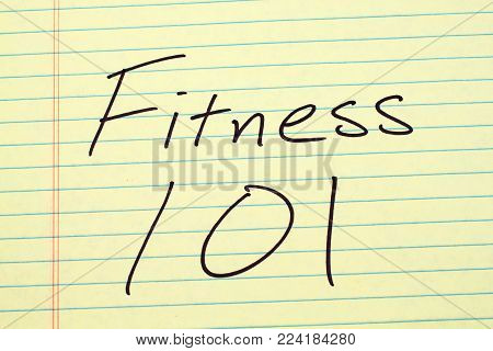 The words Fitness 101 on a yellow legal pad