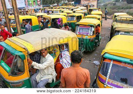 AGRA, INDIA - NOVEMBER 10: Unidentified people sit in tuk-tuks at Kinari Bazaar on November 10, 2014 in Agra, India. Agra is one of the most populous cities in Uttar Pradesh