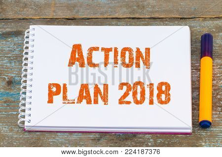Action plan 2018/ open notebook with inscription action plan , business concept.