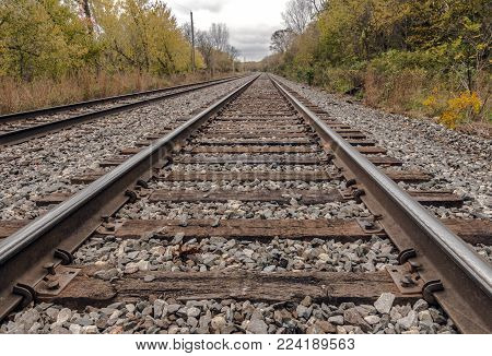 A diminished perspective of train tracks in Wisconsin.