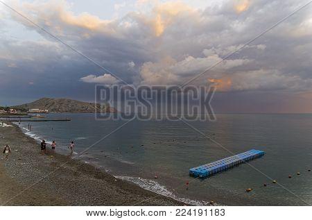 SUDAK, CRIMEA - September 6, 2017: The bay of the resort town of Sudak on a cloudy evening. Crimea.
