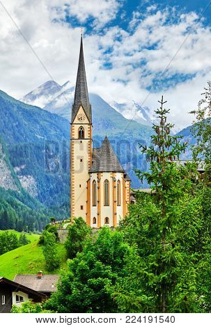 Heiligenblut Carinthia Austria picturesque landscape in mountain Alps with view at church chapel summery day blue sky and white cloud.