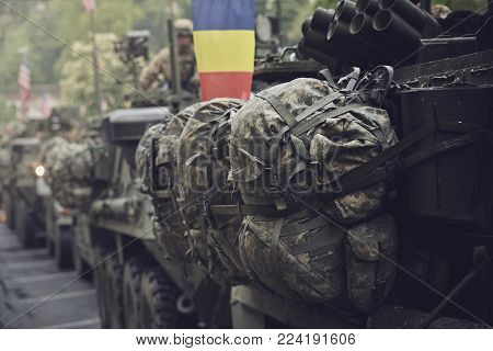 Brasov, Romania - May 14, 2015: American convoy of troops and armored vehicles march through Brasov city on their way to Cincu to take part in an international drill.