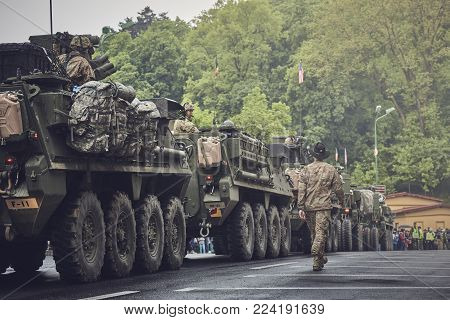 Brasov, Romania - May 14, 2015: American Convoy Of Troops And Wheeled Armored Vehicles March Through