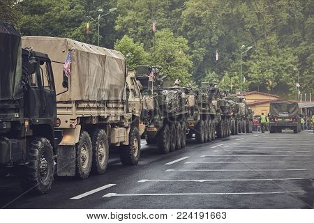 Brasov, Romania - May 14, 2015: American convoy of troops and wheeled armored vehicles march through Brasov city on their way to Cincu to take part in an international military exercise.