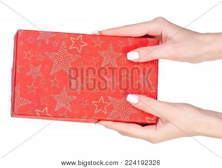 Gift box in hand on white background isolation, top view
