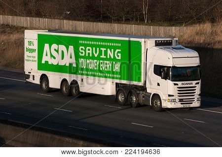 Redborn, UK - January 25, 2018: Lorry belonging to the British Asda Superstore in motion on motorway M1