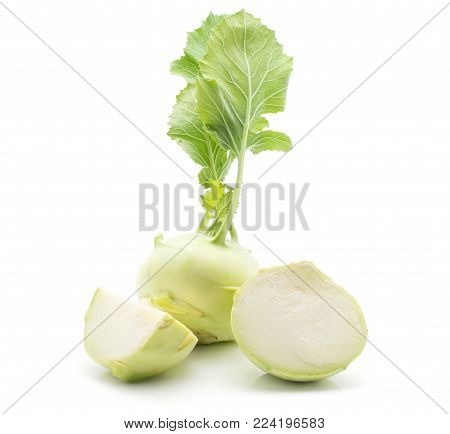 Kohlrabi (German turnip or turnip cabbage) with fresh leaves isolated on white background one bulb one half and one quarter