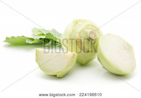 Kohlrabi (German turnip or turnip cabbage) with fresh leaves isolated on white background one bulb one half and one slice