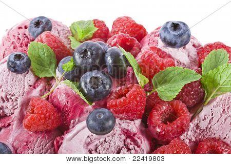 ice cream with fresh berries on white