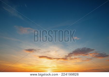 Sunset Sunrise Sky Background. Natural Bright Dramatic Sky In Sunset Dawn Sunrise. Yellow, Orange And Blue Colors.