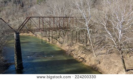 Old abandoned iron bridge over locust fork river in warrior alabama in winter