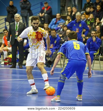 KYIV, UKRAINE - JANUARY 29, 2017: Rafa Usin of Spain (L) fights for a ball with Petro Shoturma of Ukraine during their Friendly Futsal match at Palats of Sports in Kyiv, Ukraine