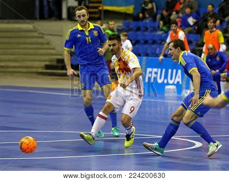 KYIV, UKRAINE - JANUARY 29, 2017: Alex Yepes of Spain (in White) kicks the ball during friendly Futsal match against Ukraine at Palats of Sports in Kyiv, Ukraine