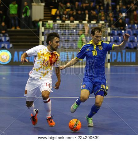 KYIV, UKRAINE - JANUARY 29, 2017: Jose A. Fernandez of Spain (L) fights for a ball with Dmytro Sorokin of Ukraine during their Friendly Futsal match at Palats of Sports in Kyiv, Ukraine