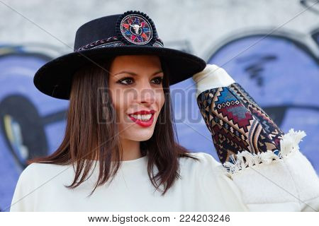 Attractive brunette girl with elegant black hat