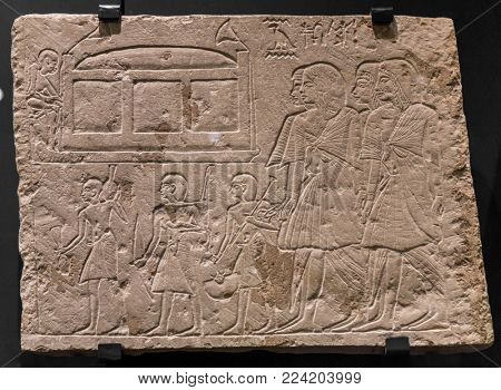 ancient stone relief at Chnum temple in Egypt