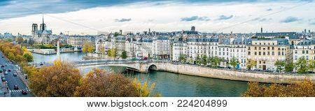 Panorama Of Notre-dame-de-paris And Seine River In Paris In Autumn